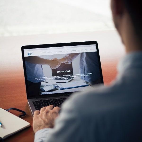 Businessman on a laptop | Procurement Co